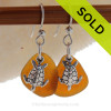 A perfect matched pair of beautiful Amber Brown Sea Glass Earrings combined with solid sterling Sea Turtle Charms and a setting that leaves much of the beauty of these sea glass pieces shine.