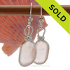 Beautiful flat lightweight peach sea glass pieces from a beach in Seaham England are set in our signature sterling silver Original Wire Bezel© setting.