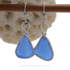 Stunning denim colored sea glass set in solid sterling silver bezel.