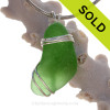 A top quality piece of Vivid Green Genuine Sea Glass in a Deluxe Triple Solid Sterling Silver  pendant setting for a necklace.
