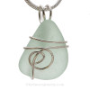 A simple and secure setting that leaves most of the sea glass pendant unaltered from the way it was found on the beach.