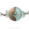 A detail of this Sea Glass Bangle Bracelet.