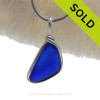 A VIVID Cobalt Blue sea glass set in our Original Deluxe Wire Bezel© necklace pendant.