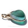A side view of this piece shows you that it is open both front and back so that you can reach up and feel the amazing texture of this 100+ year old sea glass piece.