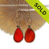 P-E-R-F-E-C-T Certified Vivid Red Orange Genuine Sea Glass in our Original Wire Bezel© earring setting lets all the color of these beautiful gold set beach found sea glass pieces shine! A beautiful match of Super Ultra Rare sea glass pieces from England. Red is the hope diamond of sea glasses and this perfect pair is a treasure for any sea glass lover and orange is the find of a lifetime!