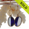 Cross Sectioned Pure White and Dark Blue Sea Glass Earrings set in our Original Wire Bezel© setting In 14K Goldfilled.