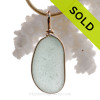 This is a beautiful Seaham Sea Green Sea Glass set in our Original Wire Bezel© pendant setting with 14K rolled gold.