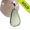 A perfect triangle of sea green Genuine Sea Glass set in our Deluxe Wire Bezel© pendant setting in Solid Sterling Silver . SOLD - Sorry this Sea Glass Jewelry selection is NO LONGER AVAILABLE!