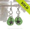 A simple smaller pair of genuine vivid green beach found sea glass earrings with sterling silver starfish charms. These are done in a simple drilled setting to let these true sea glass gems. Detailed of solid sterling charms complete this beachy look.