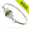 Genuine Sea Green Perfect Sea Glass Bangle set with a handmade lamp work glass wave bead with sterling end beads on a Solid Sterling half round Bangle Bracelet. This is a medium bangle at 7.75 inches.