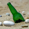 Many piece of green sea glass started out as beer and wine bottles broken and left on the beach.