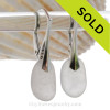 A pair of surf tumbled beach found Genuine Sea Glass Earrings in Pure White on solid sterling leverbacks.