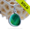 A beautiful piece of vivid teal green sea glass set for a necklace in our Original Sea Glass Bezel© in solid sterling silver setting.