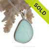 This is a beautiful LARGE  & THICK Aqua Blue Genuine Sea Glass set in our Deluxe  Wire Bezel© pendant setting .