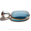 A side view shows you the thickness of the sea glass and structure of the quality silver work.