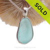 An Aqua Blue Genuine Sea Glass set in our Deluxe  Wire Bezel© pendant setting