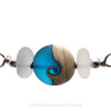 A detail of the top quality genuine sea glass pieces and the lovely handmade  deep aqua wave bead.