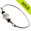 Perfect center bead of Pure White Sea Glass Is compliment with soft and hard accents of Pearls and Beach Stones in this Sterling Bangle Bracelet. SOLD - Sorry this Sea Glass Bracelet selection is NO LONGER AVAILABLE!