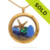 Genuine Blue Sea Glass combined with a baby starfish, emerald crystal gems  in this  Locket Necklace Goldtone Stainless Steel Locket Necklace