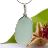 A beautiful thick and very round piece of pale seafoam green sea glass set for a necklace in our Original Sea Glass Bezel© setting THIS IS THE EXACT PENDANT YOU WILL RECEIVE!