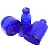 Many pieces of blue sea glass started out as medicine bottles broken and discarded into the sea.