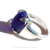 A small blue and white  beach found sea glass marble is set in this solid sterling ring. This is a secure but free floating marble and you will find yourself rotating the marble.......