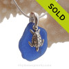 Nice Blue beach found sea glass combined with a solid sterling sea turtle charm and presented on a solid Sterling silver snake chain.