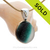 This sea glass is fused through with vivid teal green color and set in a mixed metal gold and sterling silver Deluxe Wire Bezel setting. This setting leaves this amazing natural sea glass piece just the way it was found on the beach!