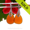 A pair of natural surf tumbled sea glass earrings in a bright Amber Brown on Solid Sterling Deco Hooks.
