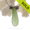 Beautiful Droplet of Seafoam Green Sea Glass Necklace On Sterling Chain with Swimming Dolphins Beads