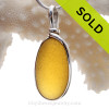 A once in a lifetime piece of large Golden Yellow sea glass is set in our Original  Wire Bezel© pendant setting in sterling silver. This setting leaves the sea glass just the way it was found on the beach in England.