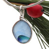 Originating as end of day art glass tossed into the sea. Glass from this region tends to be the best in the world. Most likely the remnants of a broken attempt of a vintage Hartley and Wood vase Circa 1900, the historical source of this amazing sea glass pendant piece. Color is NOT APPLIED but was fused into the glass over 100 years ago.