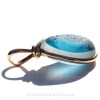 A side view shows you the thickness of the sea glass in the pendant and the quality of the bezel work.