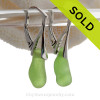 A pair of natural surf tumbled sea glass earrings in a brilliant lime or chartreuse green on solid sterling leverbacks.