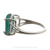 An unaltered aqua green sea glass piece set in a simple sterling basket ring.