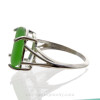 An unaltered  green sea glass piece set in a simple sterling basket ring.