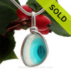 An stunning combination of vivid mixed vivid aqua with a contrast of pure white in this very old English Sea Glass piece and set in our Original Wire Bezel© necklace pendant setting.