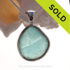 Elegant Embossed Large Aqua Blue Genuine Sea Glass in our In Our Deluxe Sterling Wire Bezel© Necklace Pendant.