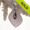 A perfect piece of Deep Purple Certified Genuine Sea Glass in a sterling necklace with a flip flop charm. Solid Sterling professionally hand cast bail. Stunning Purple Sun Glass from the Island of Betsy Wyeth in Maine.