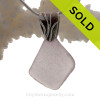 A nice piece of Purple Sun Glass WWI Era Sea Glass Necklace On Sterling Coral Branch Bail- Solid Sterling Chain INCLUDED
