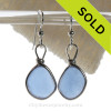Perfect Carolina Blue sea glass pieces set in a sterling silver earring in our Original Wire Bezel© earring setting.