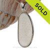 A nice piece of top quality pure white English sea glass pendant set in our Deluxe Wire Bezel© setting.