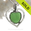 A beautiful Green natural sea glass heart set in our deluxe wire bezel pendant setting!  Genuine sea glass hearts are a RARE phenomena and cherished among sea glass lovers!