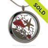 Ruby Red Real sea glass pieces combined with a real starfish a sterling hearts charm, a ruby red gem and real beach sand in this JUMBO 35MM stainless steel locket. SOLD - Sorry this Sea Glass Jewelry selection is NO LONGER AVAILABLE