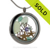 A great sea glass locket necklace for anyone, specially those with an February birthday! Seafoam Green and Aqua Sea Glass, two tiny stafish and beach sand.