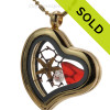 A Ruby Red heart shaped Beach Found Sea Glass Heart in a Goldtone Locket Necklace W/ a real baby Starfish and Diamond Crystal Gem