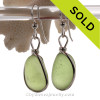 Lovely frosted and thick Peridot Green beach found Sea Glass Earrings set in our signature Original Wire Bezel© setting in silver. This sea glass is unaltered from the way it was found on the beach. Elegant and Timeless.