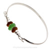 Two Honey Amber Sea Glass pieces and a Vivid Green Sea Glass on this Solid Sterling  Half Round Bangle Bracelet.