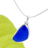 A vivid cobalt blue sea glass piece set in our signature Original Wire Bezel© setting. The piece is UNALTERED from the way it was found on the beach. Good quality GENUINE sea glass!