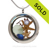 """Beautiful  Blue and Sea Green Genuine Beach  Glass Locket with a real starfish and beach sand, finished with a vivid brilliant cut CZ gem """"Diamond"""" great for any April Beach Baby!"""